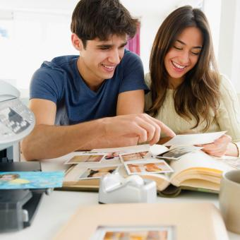 couple printing photographs together