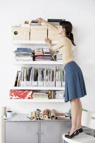Woman Reaching for Shelf