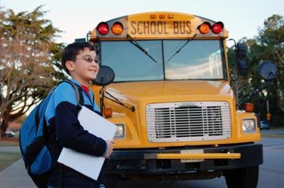 school boy and bus