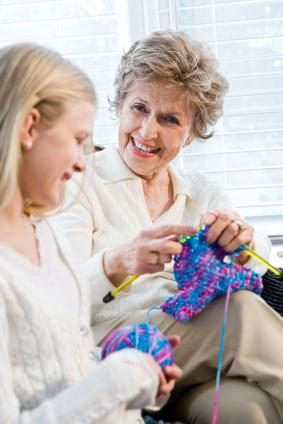 Grandma and granddaughter knitting