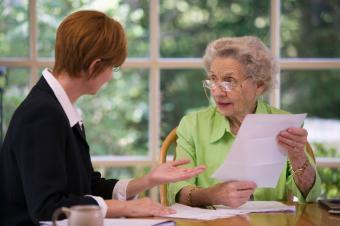 Elderly woman receiving financial assistance