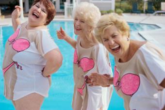 Senior women laughing next to pool