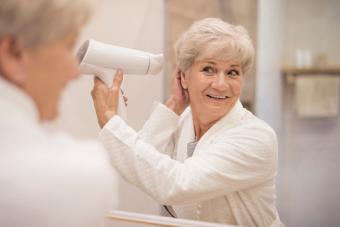 senior woman drying hair