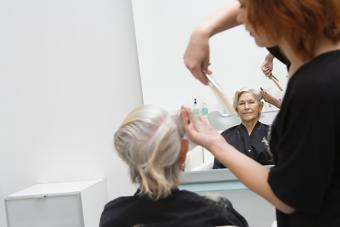 https://cf.ltkcdn.net/seniors/images/slide/224226-704x469-Stylist-cuts-elderly-womans-hair.jpg