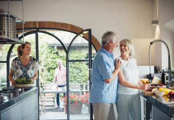 Seniors entertaining guests in large kitchen