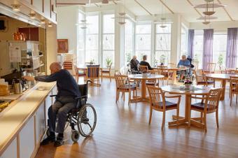Senior man getting coffee in dining room