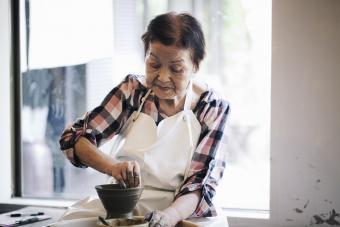 Elderly woman working with ceramics
