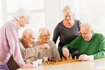 Senior people playing chess