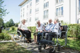 Senior man and women spending time together at garden