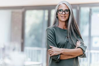 Woman with straight hair wearing glasses