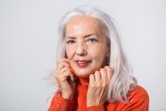 Senior Woman Smiling With Peachy Flush Make Up