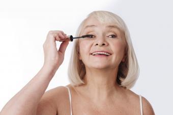 Woman using a mascara brush