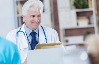 doctor talks with patient
