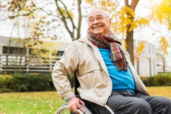 Man in wheelchair in lightweight jacket