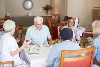 Seniors enjoying a group lunch