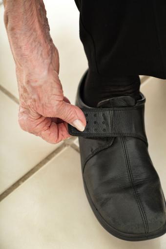 arthritic hand fastens velcro shoe closure