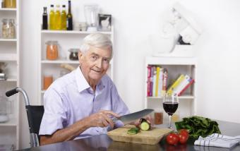 senior man preparing salad