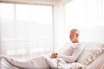 senior man lying in adjustable bed