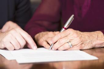 Senior woman signing some legal papers