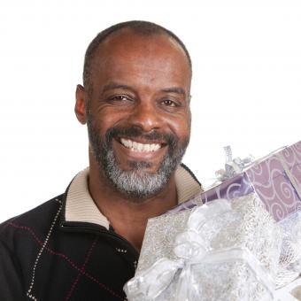 https://cf.ltkcdn.net/seniors/images/slide/241049-500x500-retired-man-holding-gifts.jpg