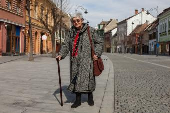 Senior woman walking with a cane