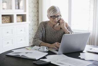 senior woman paying bills