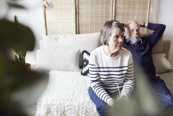 Senior couple sitting in living room