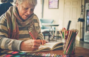 senior woman using an adult coloring book