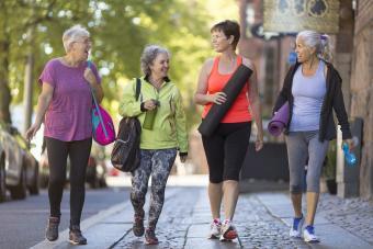 Senior women walking together to yoga class