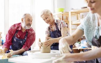 Seniors using pottery wheel in studio