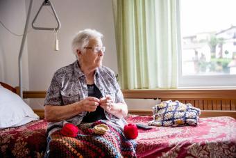Senior crocheting in retirement home