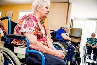 Seniors in wheelchairs in retirement home