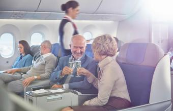 Retire couple traveling on airplane