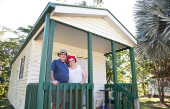 Seniors Couple in front their mobile home