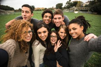 friends take a selfie at the park
