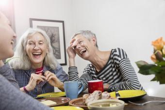 Teachers laughing, having lunch