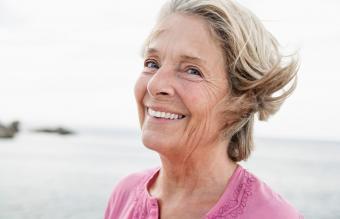 woman smiling at Atlantic ocean