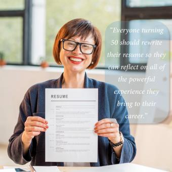 woman holding up her resume