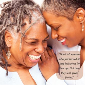 Two smiling older women