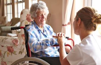 Elderly woman in retirement home