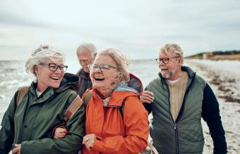 Seniors walking on the beach