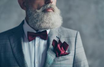 man wearing burgundy bow-tie