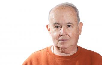 Elderly man looking into camera