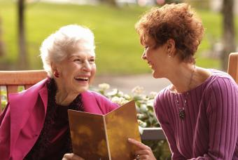 Women laughing over greeting card message