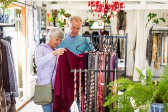 Senior couple shopping shawls