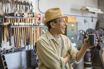 Man in car shop laughing