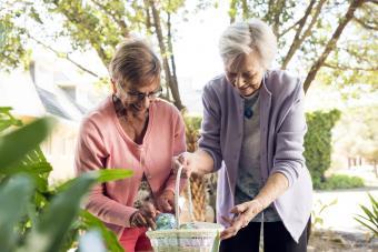 Senior women creating Easter basket
