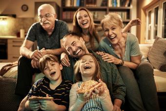 Senior couple hosting family movie night
