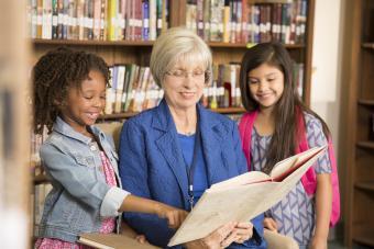 Senior woman reading to children