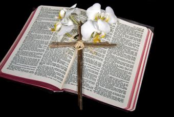 Twig cross with Bible and Easter lilies